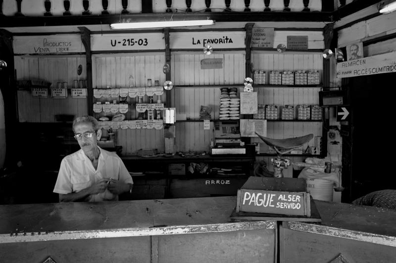 Interior of Cuban ration store, a hallmark of the Revolution that will soon open its doors to foreign investment, while excluding Cubans. Photo: Glass&Tubes via Flickr.