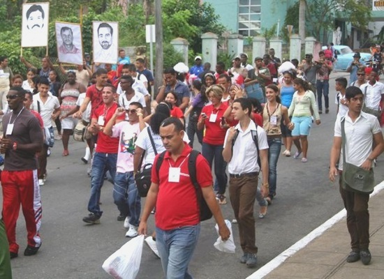 "Young Cubans marching in a government sponsored ""protest"""