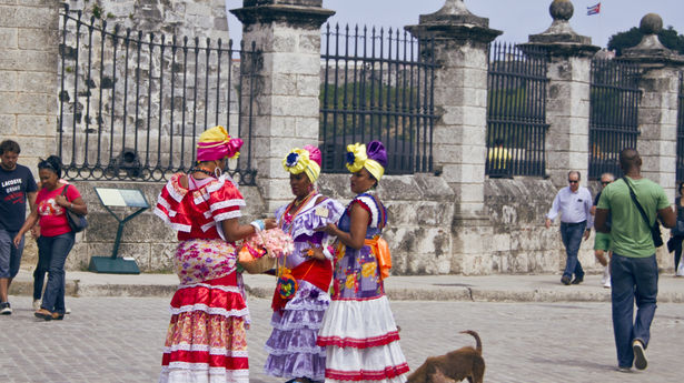 Women dress up in costume to earn a few convertible pesos from the foreign tourists in the historic center of the city