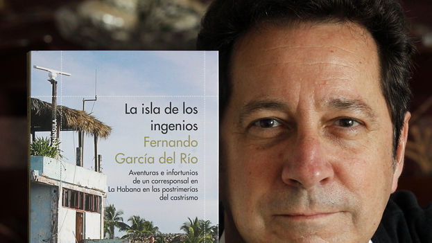 """Fernando Garcia poses with a copy of his book 'The Island of the Ingenuous"""". (Photo: Esteban Cobo)"""