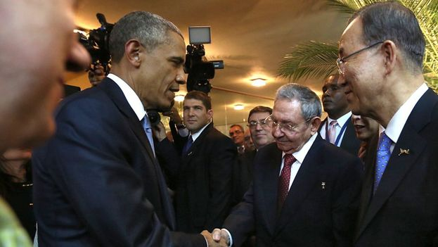 Barack Obama and Raul Castro shake hands at the opening of the Americas Summit