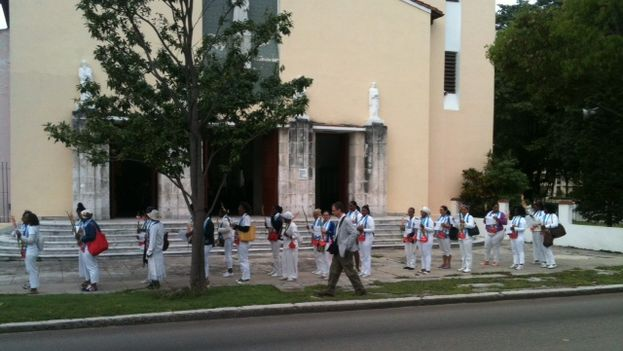 Ladies in White outside of the parish of Santa Rita in Havana. (Angel Moya)