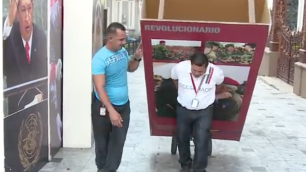Photographs of former President Hugo Chavez being removed from Parliament. (Youtube)