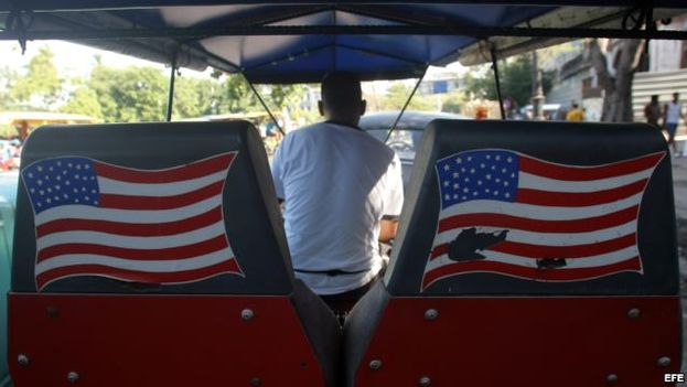 A man pedaling a pedicab with the American flag through the streets of Havana. (EFE)