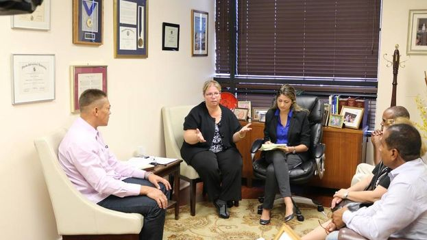 Former Cuban political prisoners Niorvis Rivera (left) Aracelio Riviaux and Jorge Ramirez (right) speak with staff for Congresswoman Ileana Ros-Lehtinen. (Courtesy)