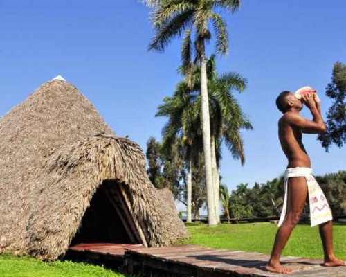 "In the ""Taíno"" village ""Guamá"" blowing into a conch shell (photo Martí News)"