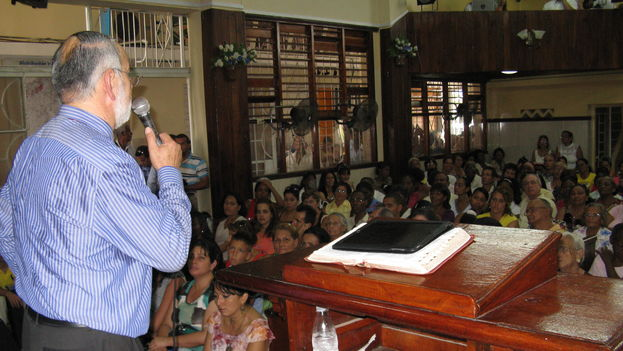 Minister holds a service in the Cuban Evangelical Church League (Hispanic Evangelical Church)
