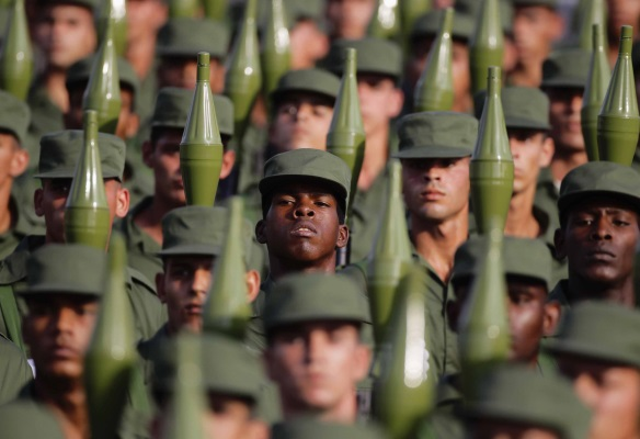 Cuban soldiers carry rocket propelled grenade launchers during a military parade in Havana's Revolution Square April 16, 2011.