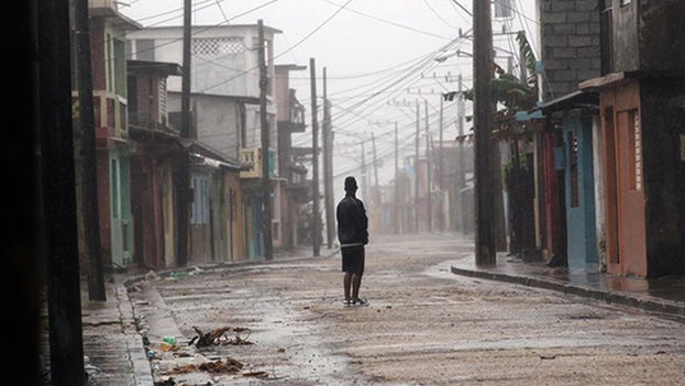 A man stands in the street in the city of Baracoa, in Guantanamo. (EFE)