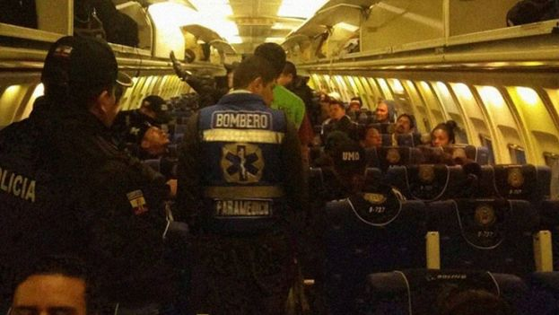 "Cuban citizens being deported from Ecuador. ""Bombero"" - firefighter, in this case a medic. (Ecuador Interior Ministry)"
