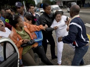 Cuban protester arrested by State Security officials, December 10th, 2014. (AP)