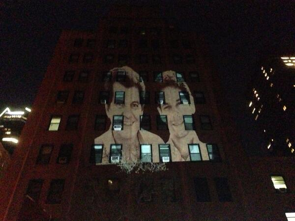 The faces of Oswaldo Paya and Harold Cepero projected on the facade of the Cuban Mission to the United Nations, 38th and Lexington in New York City