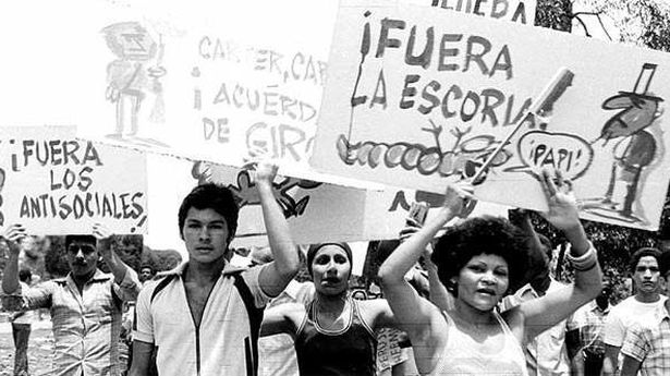 """Supporters of Fidel Castro's government marched with signs calling for the """"scum"""" and """"antisocials"""" to be thrown out of the Island."""