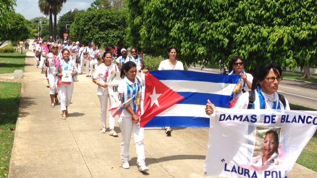 Ladies in White walking down 5th Avenue in Miramar. (14ymedio)