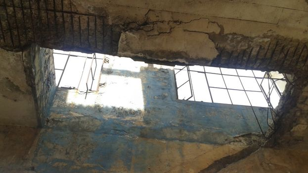 Water from recent rainstorms seeps in through ceiling cracks at Cuatro Caminos.