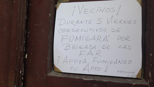 """Sign warning of fumigation. """"Neighbors! For 5 consecutive Fridays the FAR (Revolutionary Armed Forces) Brigade will be fumigating. Help fuigate your apartment! CDR (Committee for the Defense of the Revolution) Executive (14ymedio)"""