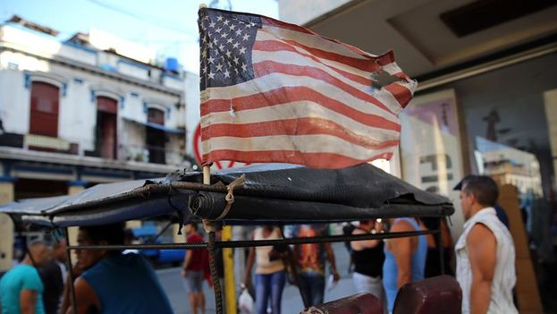 An American flag flies on a pedicab Monday in Havana. (EFE)