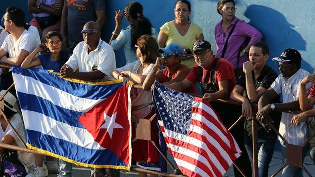 United States and Cuban flags in the streets of Havana